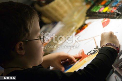 istock boy painting 183361639