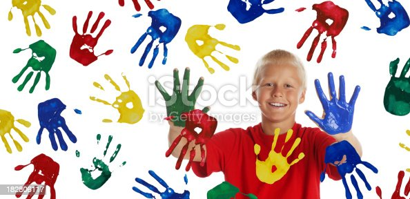 123499844istockphoto Boy Painting with his Hands on White 182806117
