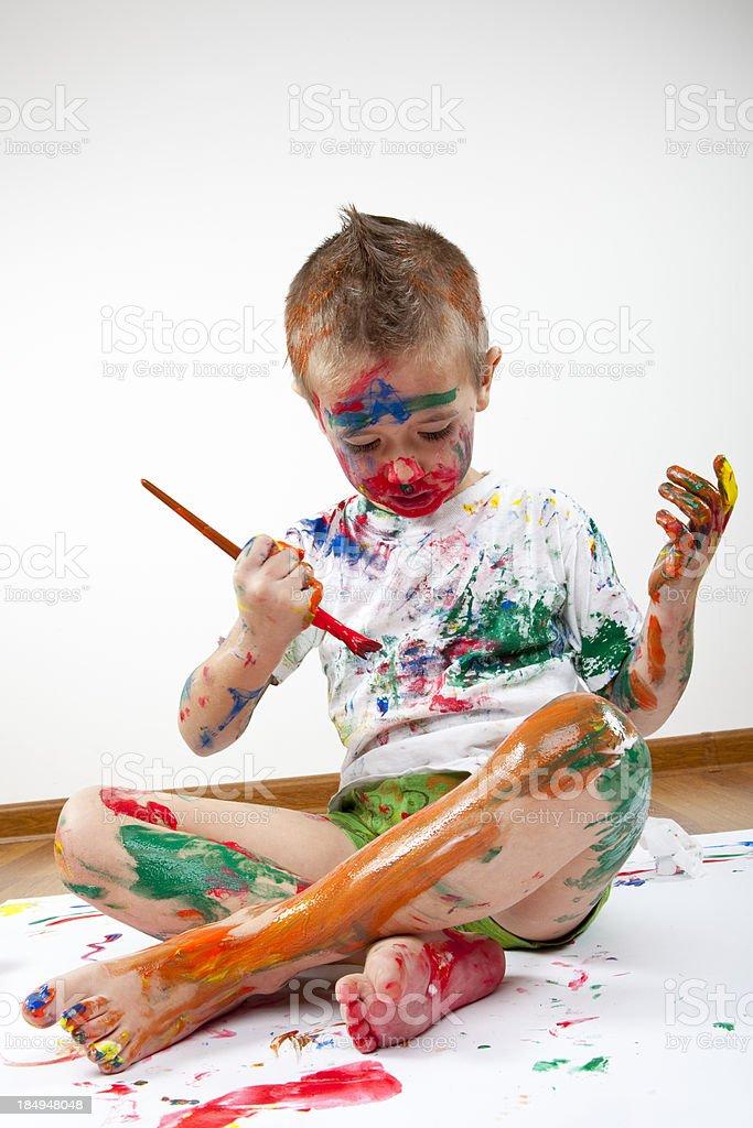 boy paints XXXL stock photo