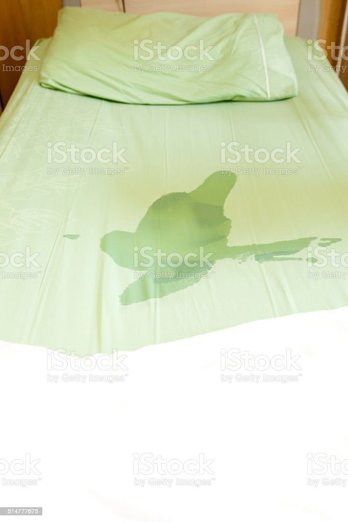 Boy pee on the bed stock photo