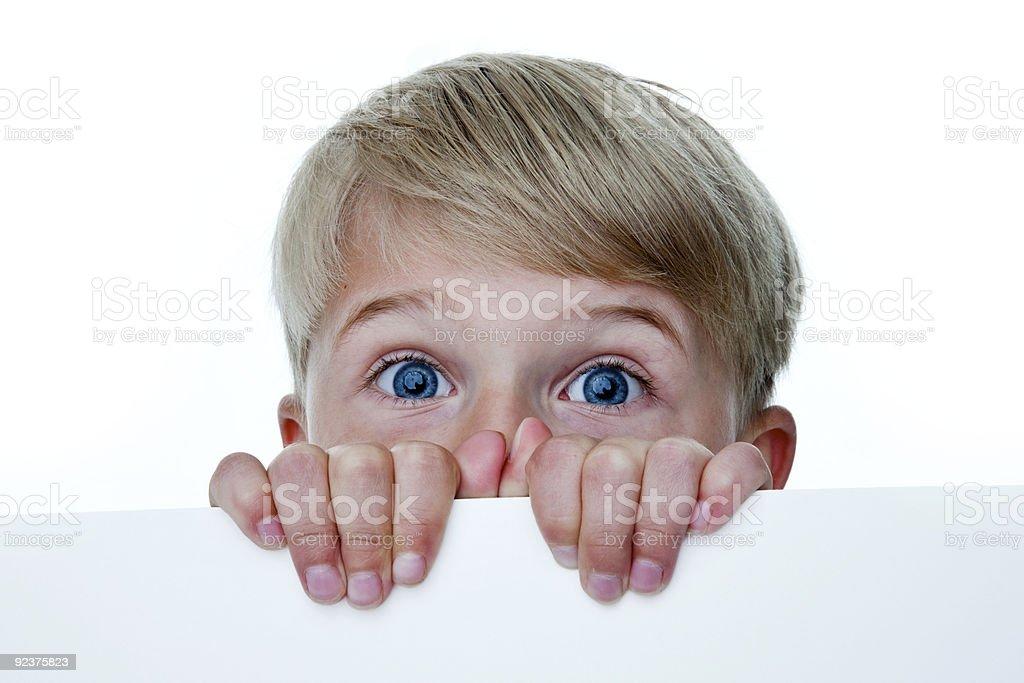 Boy peeking over wall royalty-free stock photo