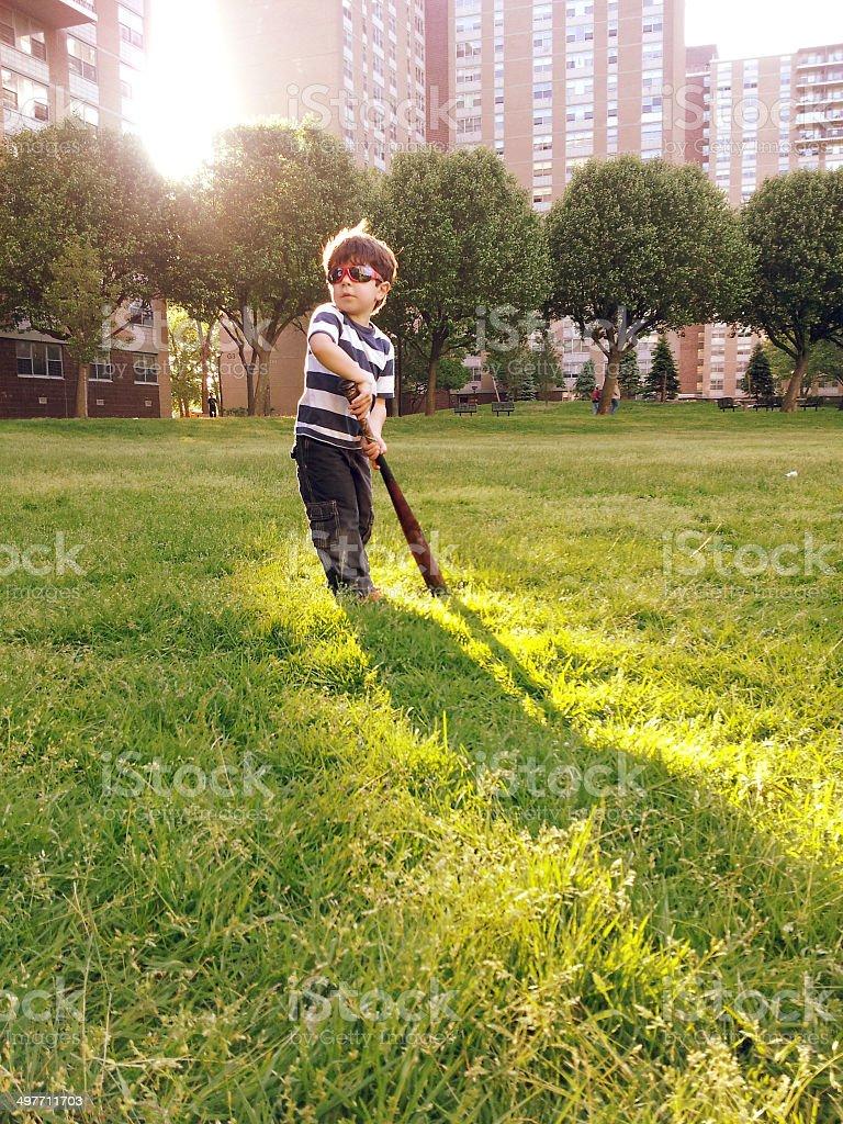 Boy play baseball at the lawn royalty-free stock photo