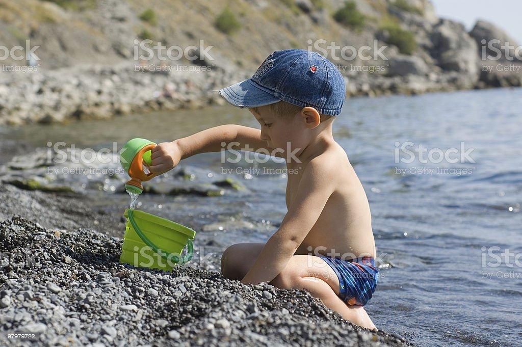 boy play on the beach royalty-free stock photo