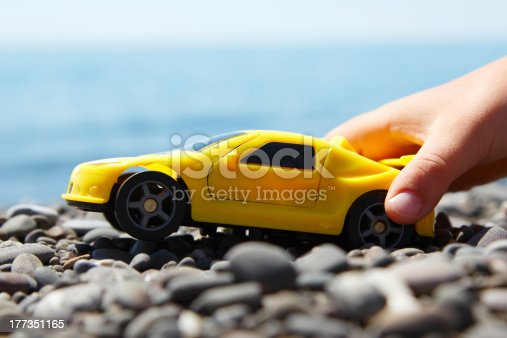 147878016 istock photo boy play with a car summer beach outdoor 177351165
