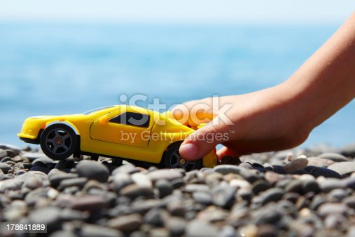 147878016 istock photo boy play with a car summer beach outdoor 178641889