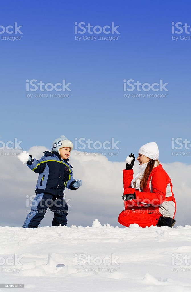 Boy played with mother in winter park royalty-free stock photo