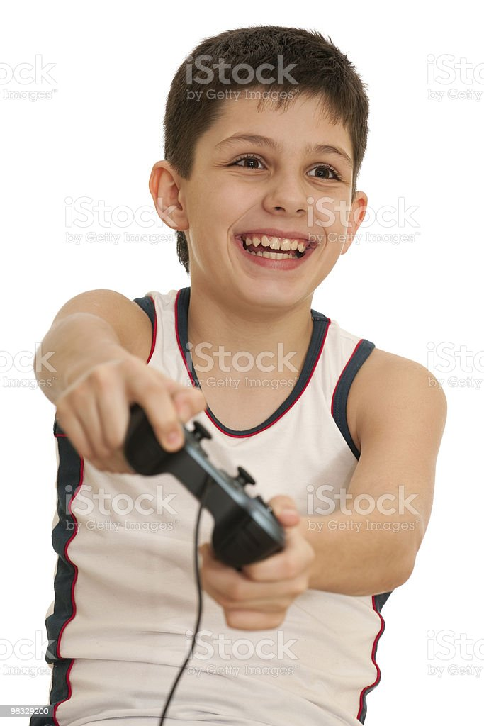 Boy playing a computer game with joystick royalty-free stock photo