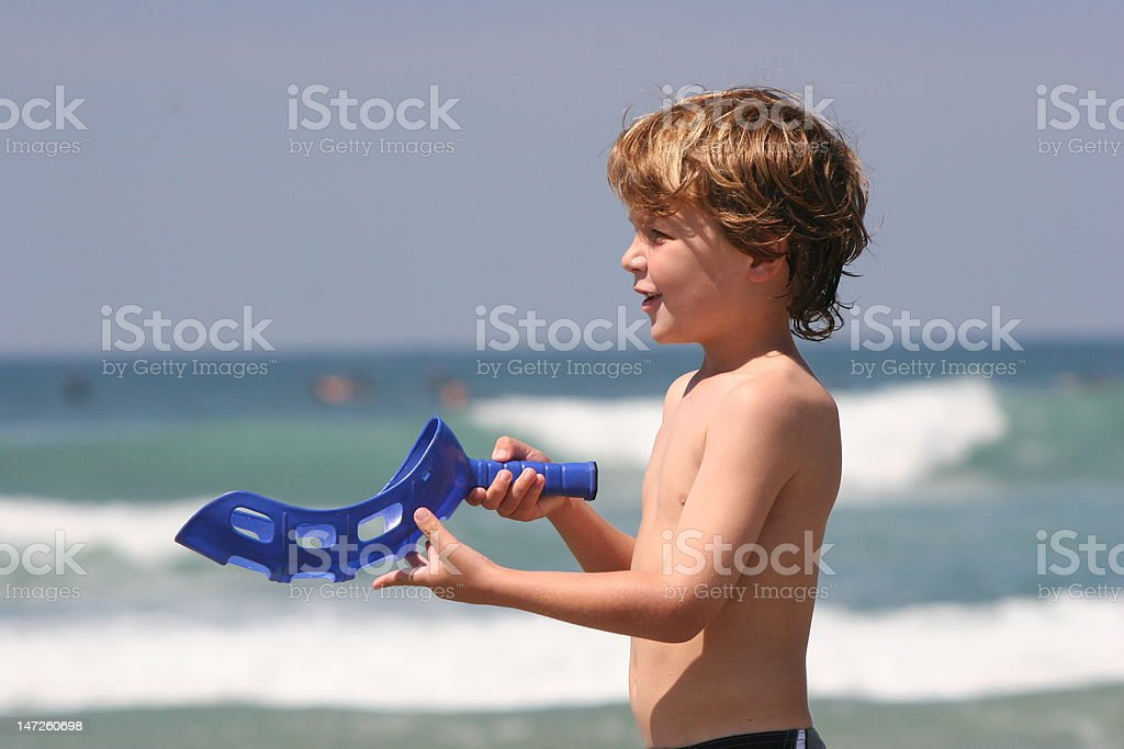 Boy Playing at Beach stock photo