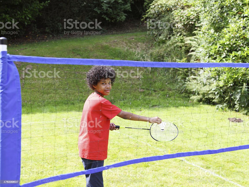 boy playing badmingtom royalty-free stock photo