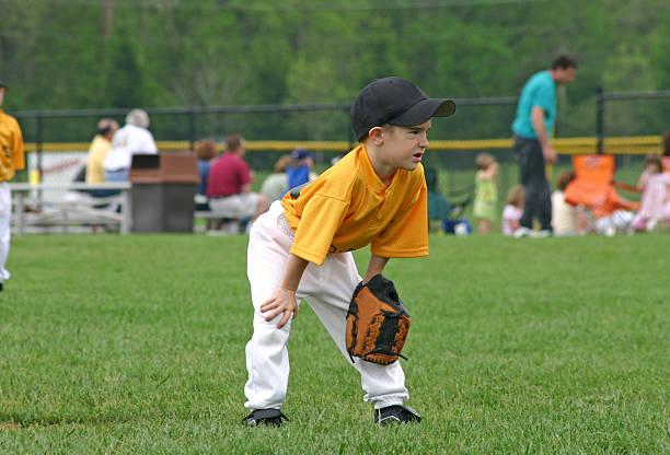 boy playing baseball stock photo