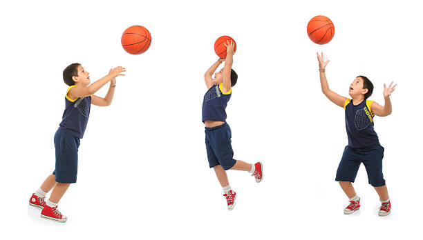 Boy playing basketball isolated stock photo