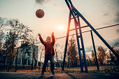 Young boy playing basketball