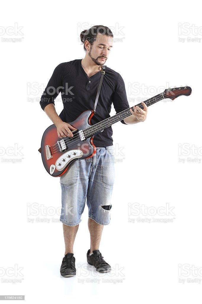 Boy playing bass stock photo