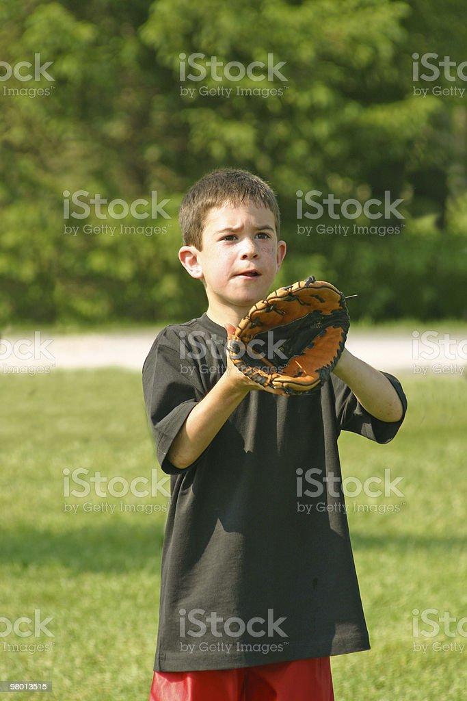 Boy Playing Catch royalty free stockfoto