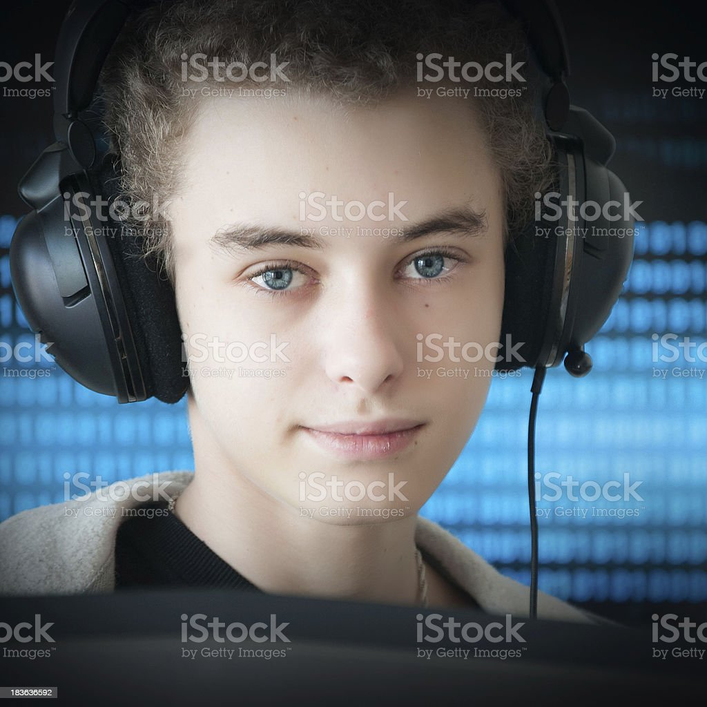 Boy playing computer game stock photo