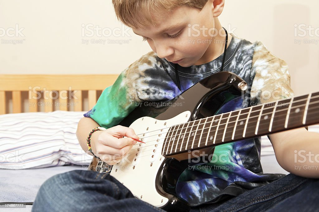 Boy Playing Electric Guitar royalty-free stock photo