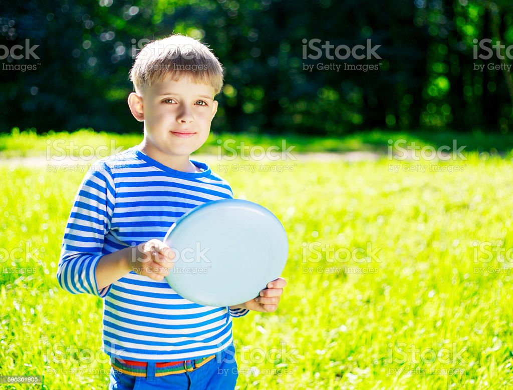 Boy playing frisbee royalty-free stock photo