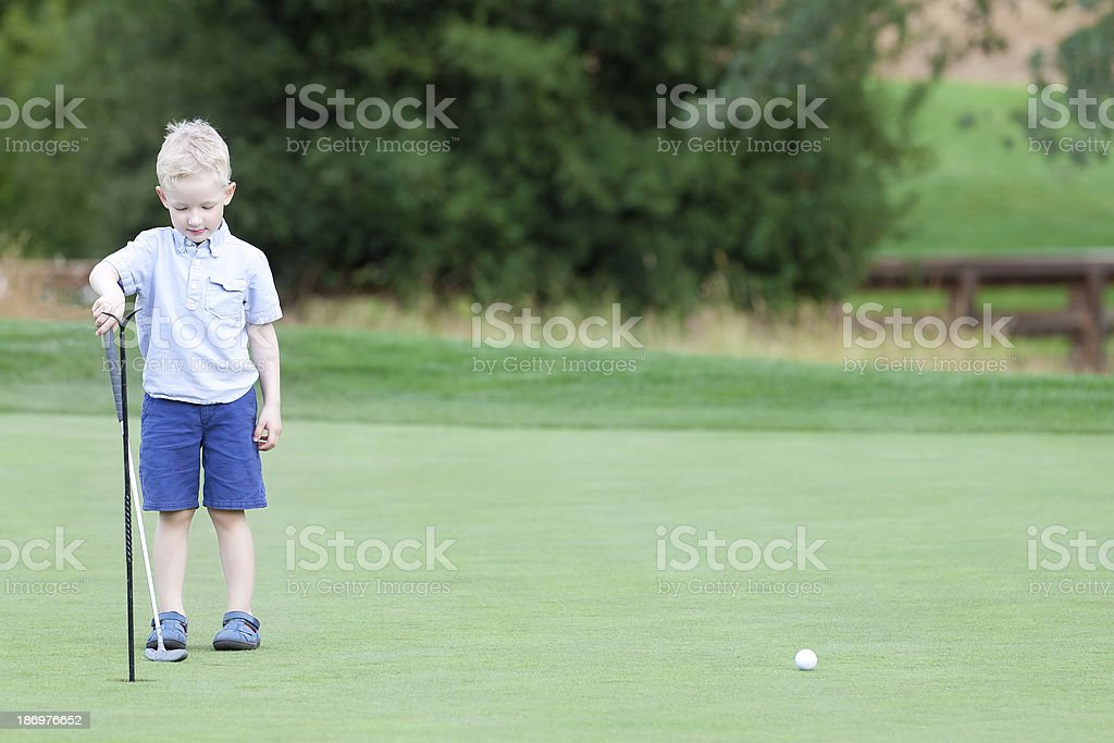 boy playing golf royalty-free stock photo