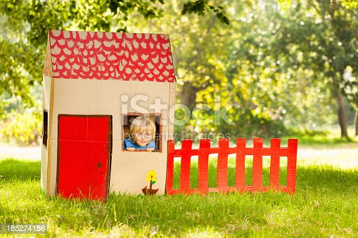 Cute little boy playing in a playhouse. Horizontal Shot. Please checkout our lightboxes