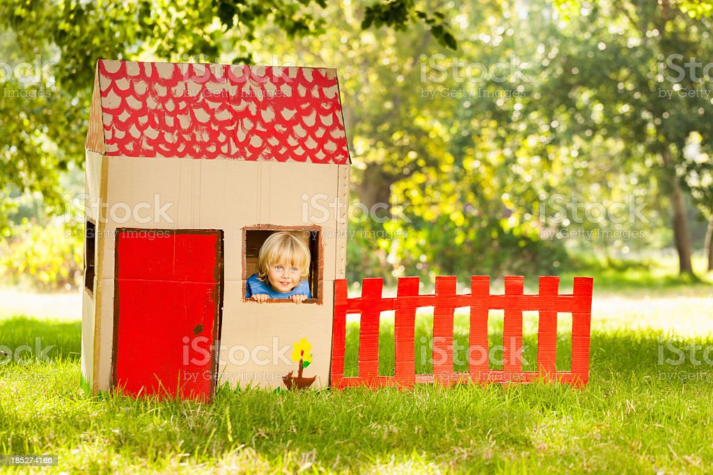 Boy Playing In a Playhouse stock photo