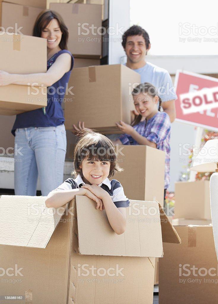 Boy playing in box near moving van royalty-free stock photo