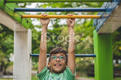 Little boy climbing on the playground
