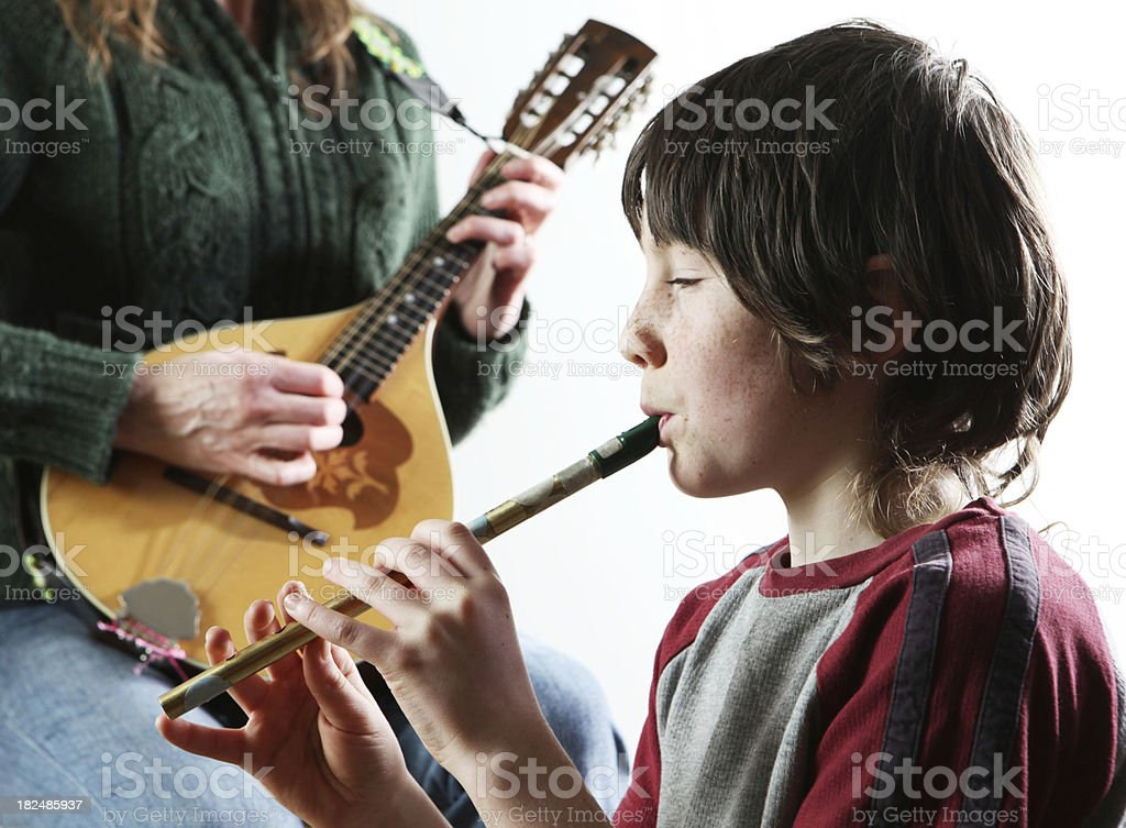 boy playing on tin whistle stock photo