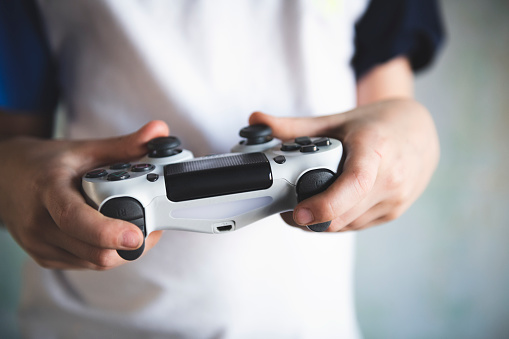 istock Boy playing on video computer game controller 1133845889