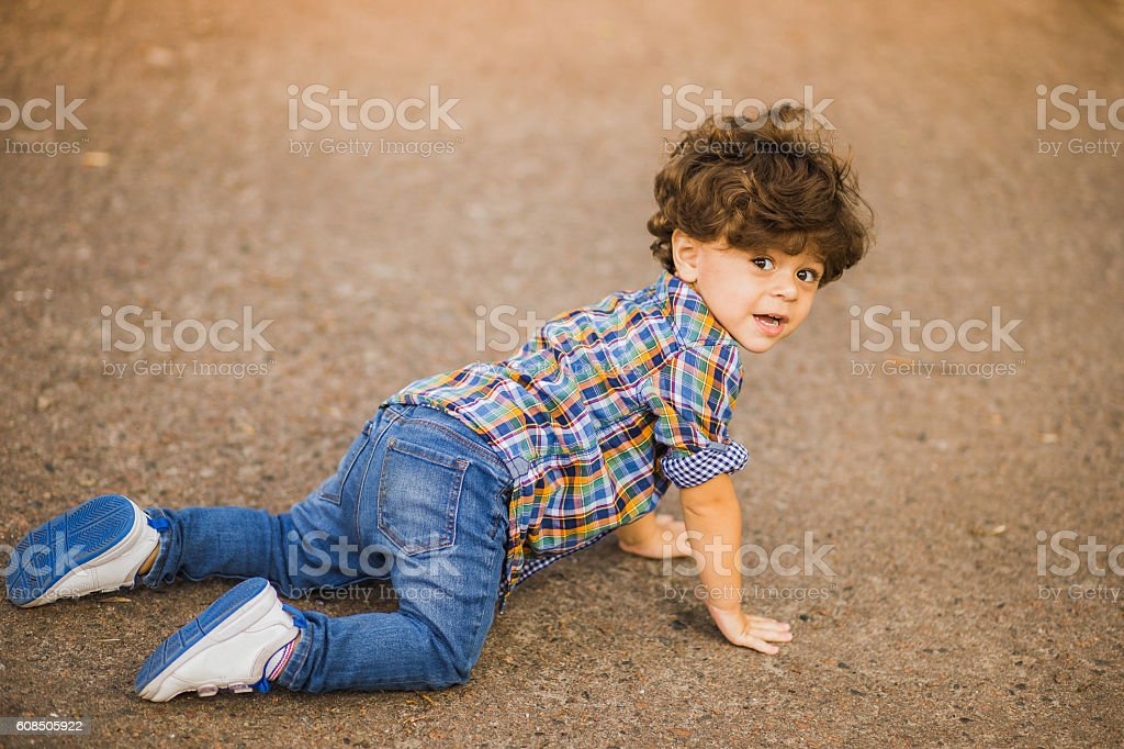 Boy playing outdoors stock photo