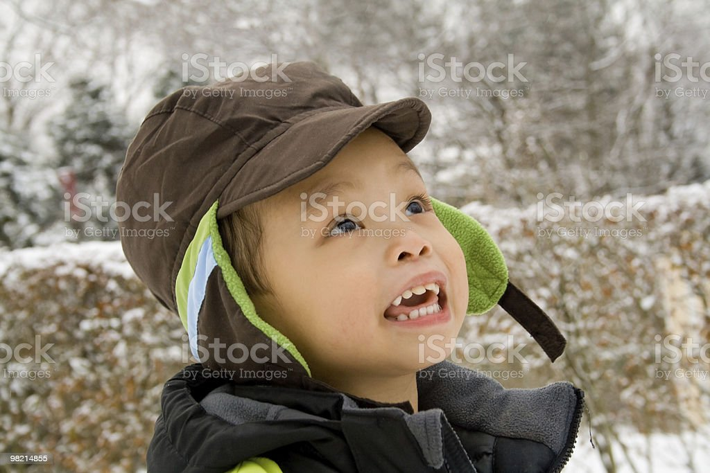 Boy playing outside during winter royalty-free stock photo