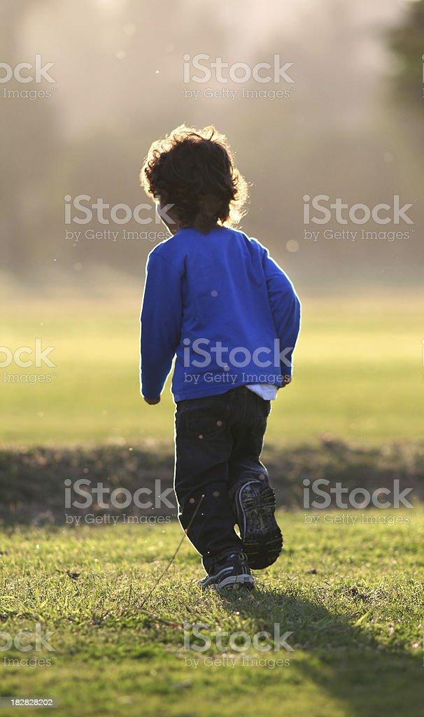 boy playing outside royalty-free stock photo