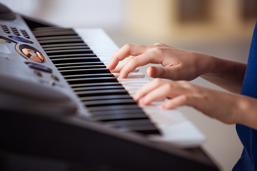 Boy Playing Piano In Training Class Stock Photo - Download Image Now