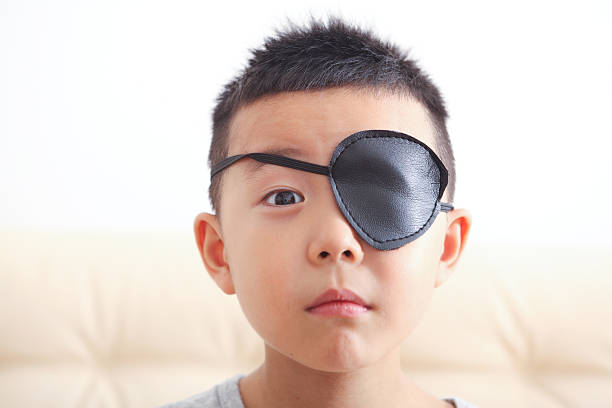 Boy playing pirate Boy playing pirate costume eye patch stock pictures, royalty-free photos & images