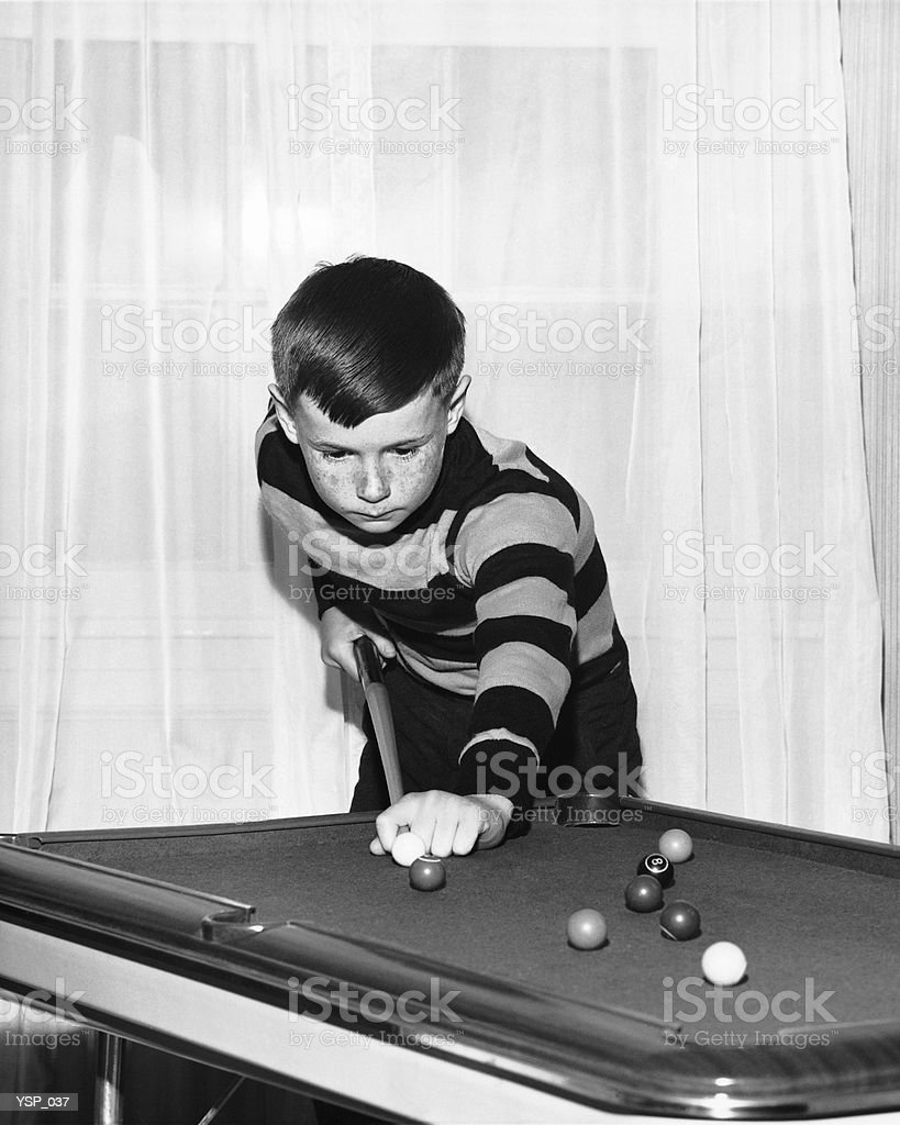 Boy playing pool royalty-free stock photo