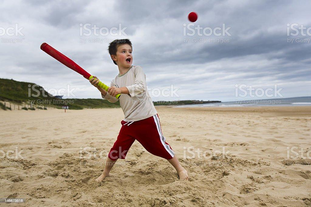 Boy playing softball stock photo
