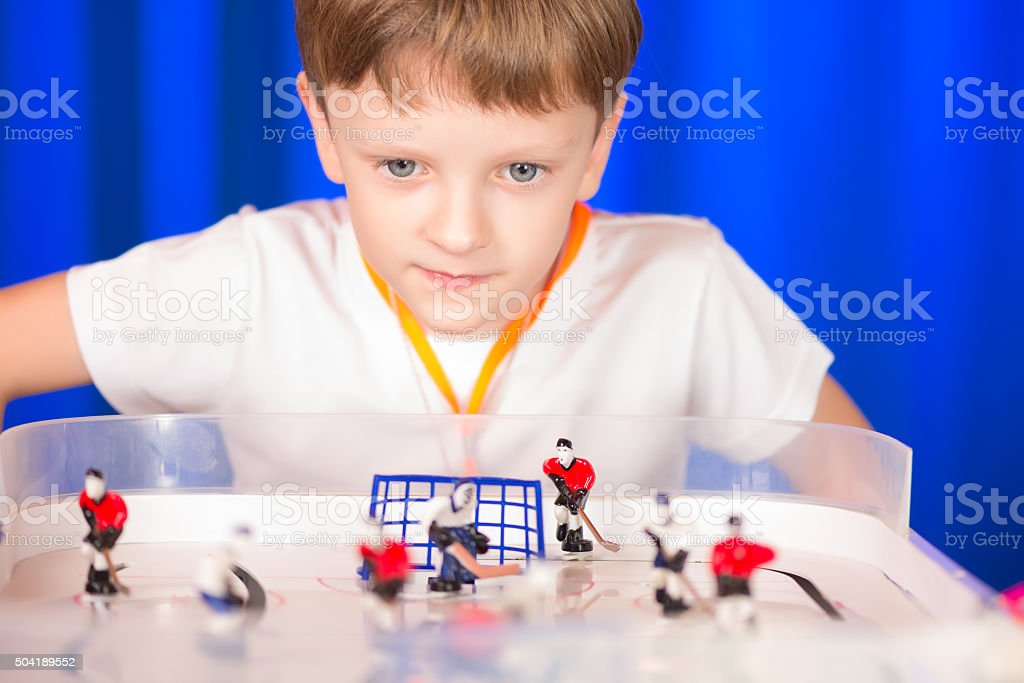 Boy playing table hockey stock photo