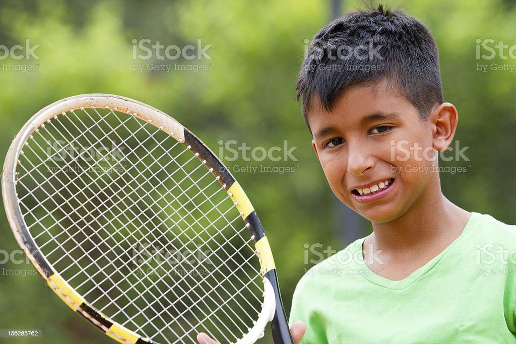 Boy playing tennis royalty-free stock photo