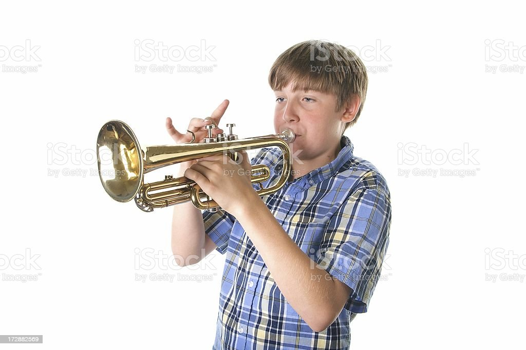 Boy Playing the Trumpet on a White Background stock photo