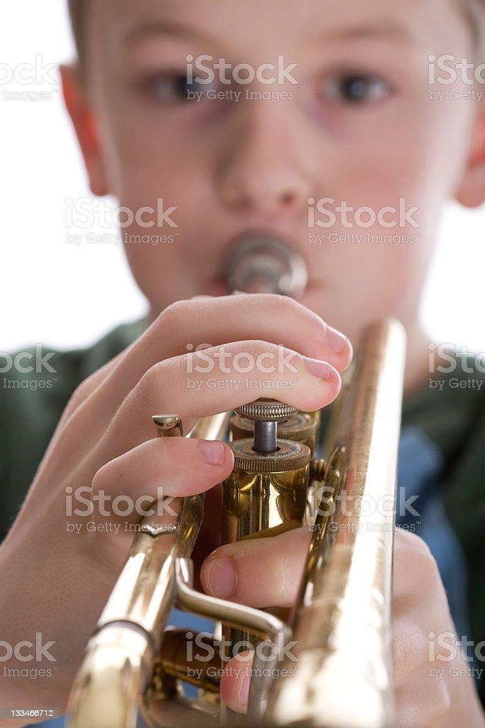 Boy playing trumpet royalty-free stock photo