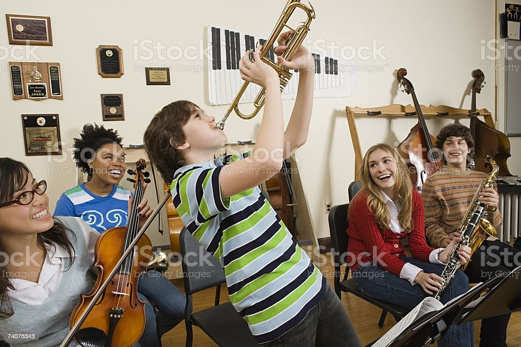 Boy playing trumpet stock photo