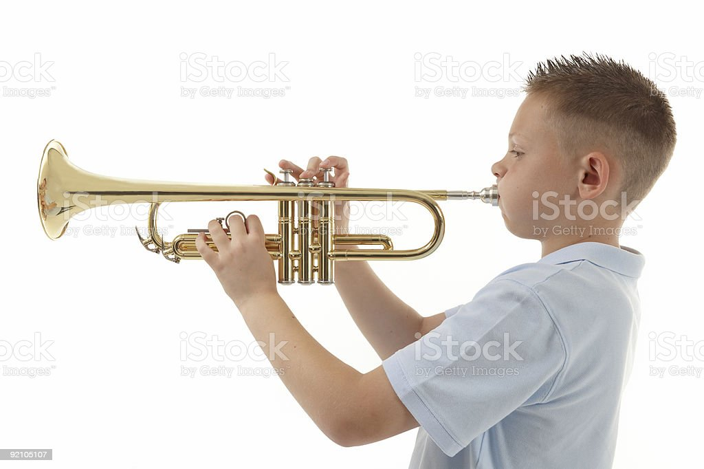 Boy playing Trumpet royalty-free stock photo