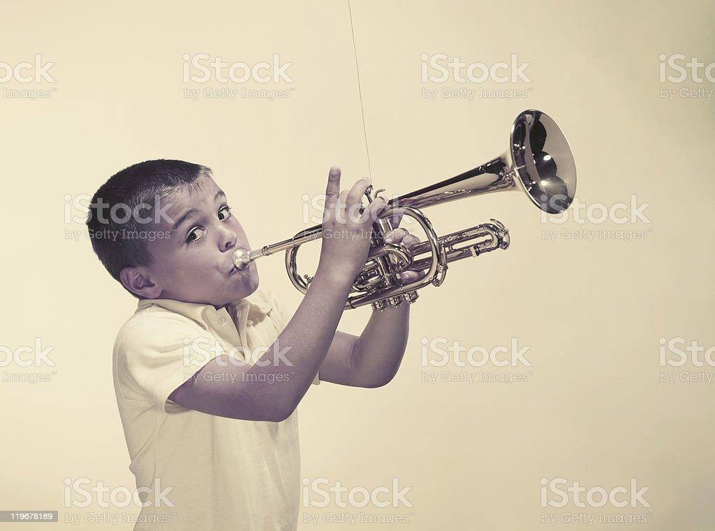 Boy playing trumpet, portrait stock photo
