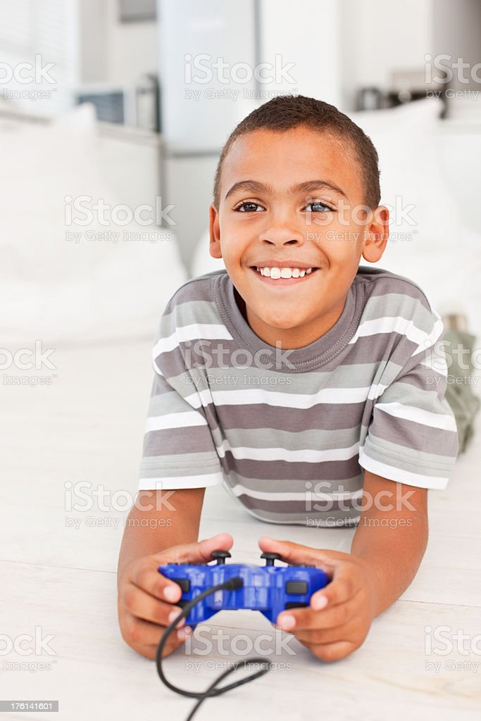 Boy playing video game royalty-free stock photo