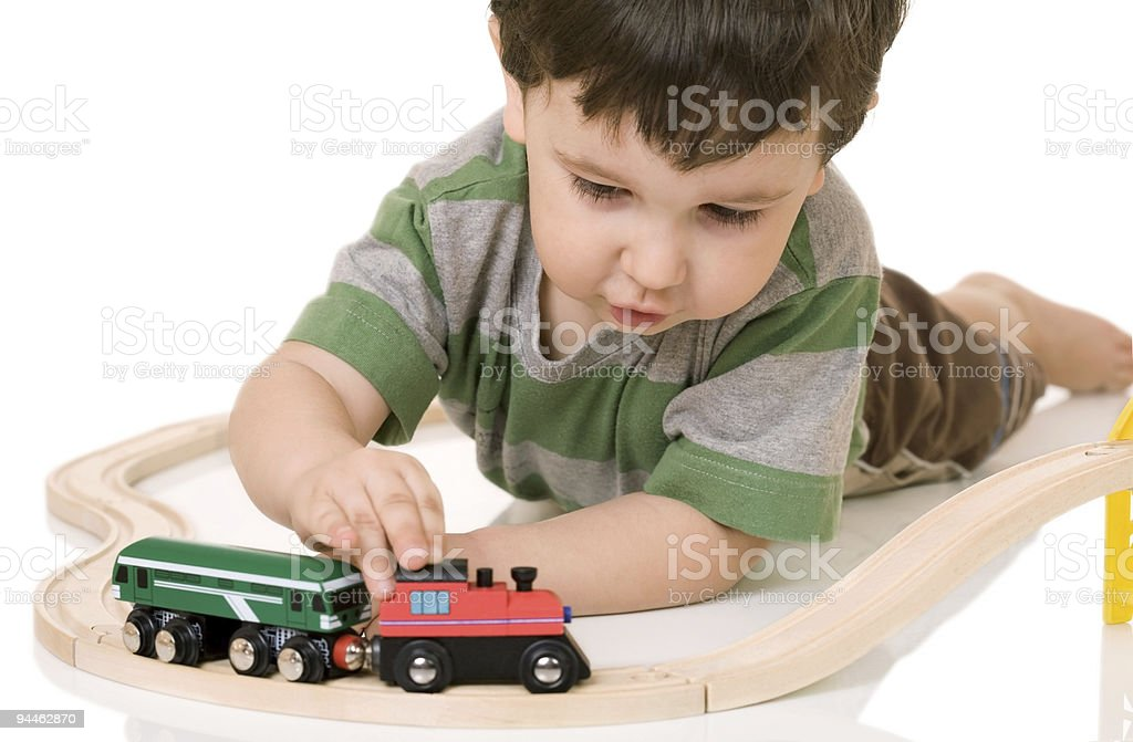 boy playing with a train set royalty-free stock photo