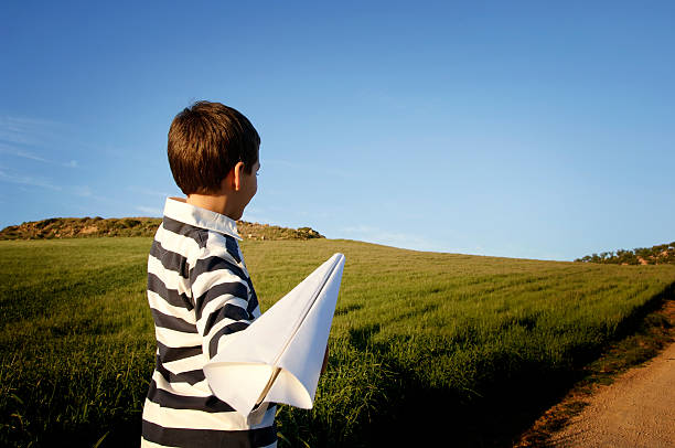 Boy playing with airplane stock photo
