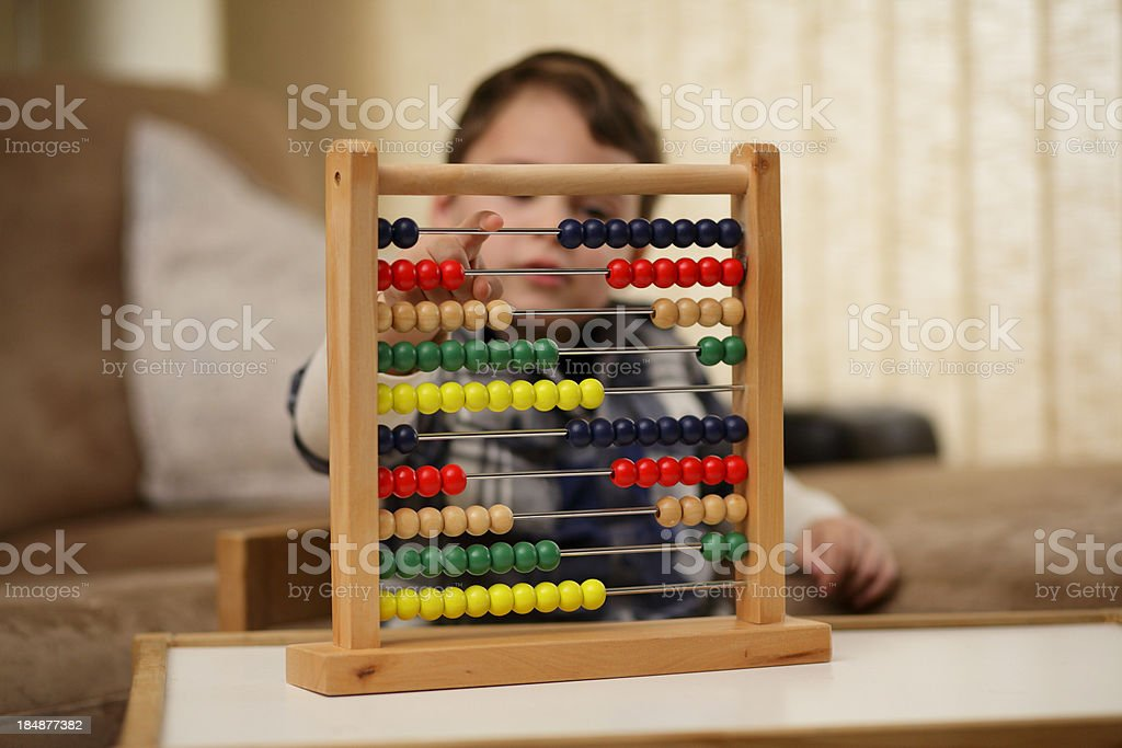 Boy playing with an abacus stock photo