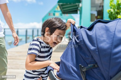 istock Boy playing with baby 838486608