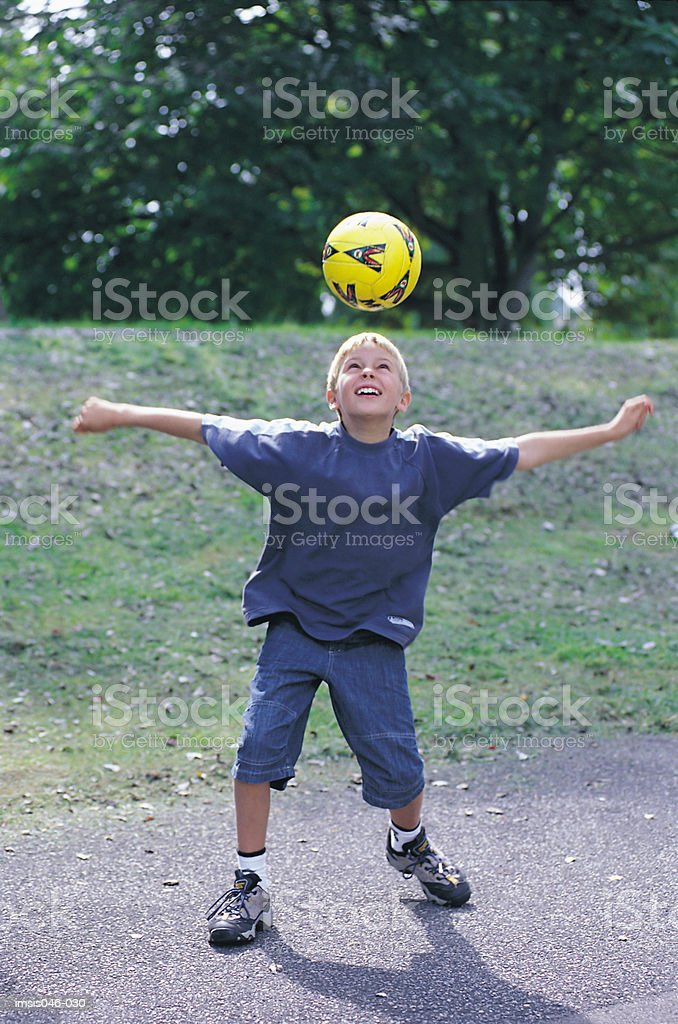 Boy playing with ball royalty-free stock photo