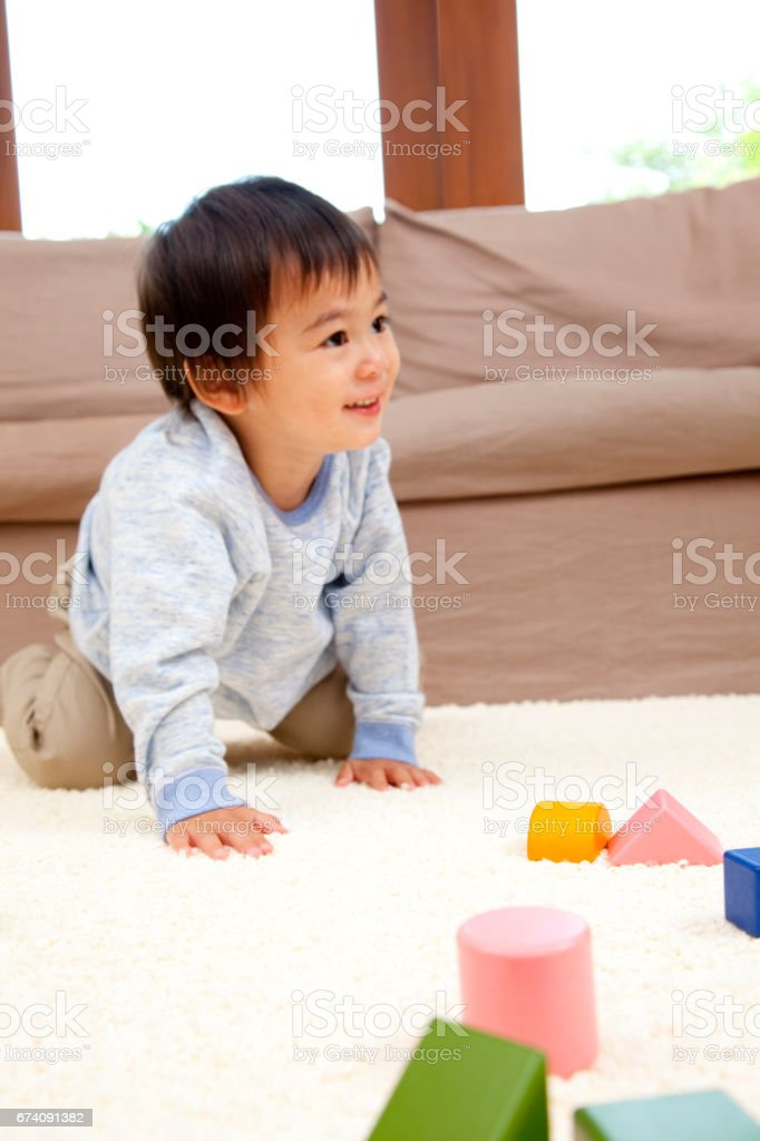 Boy playing with blocks royalty-free stock photo