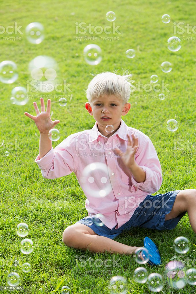 Boy playing with bubbles royalty-free stock photo